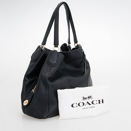 A coach shoulder bag.