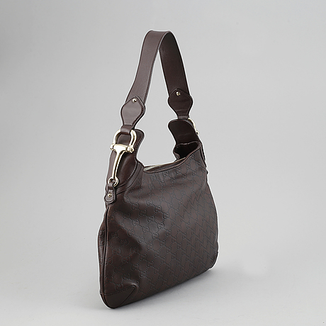 Gucci, a leather bag.
