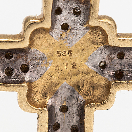 A 14k gold cross with diamonds ca. 0.12 ct in total according to engraving.