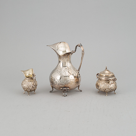 A silver pitcher, creamer and sugar bowl, including stiltenn sven carlsson, stockholm 1960.