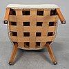 Fritz henningsen, a fritz hansen easy chair, denmark, mid 20th century.