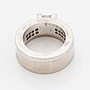 Rolf karlsson, three rings, 18k white gold with princess-cut and brilliant-cut diamonds, and two band rings.