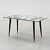 Marian zawadzki, a ceramic tile table, tilgmans, signed mz and dated 58.