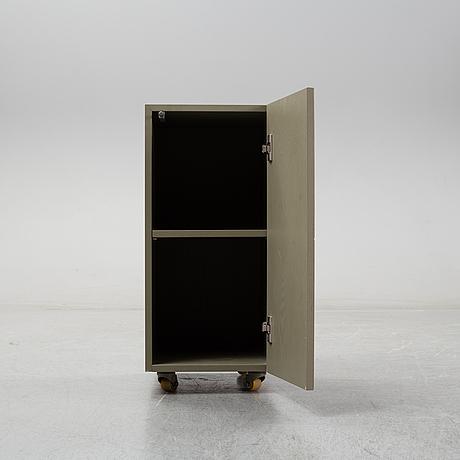 Note design studio, a cabinet, custom made for hidden tints; made by lerch snickeri & inredningar.
