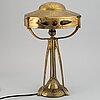 An art nouveau brass table lamp.