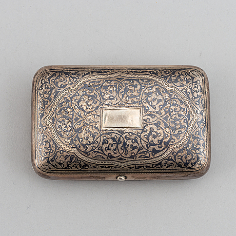 A russian parcel-gilt silver and niello cigarette case, unidentified makers mark, moscow 1891.