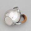 A sterling silver pitcher, helsinki, finland 1963.