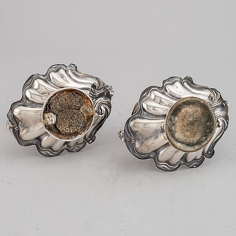 A pair of silver night light holders, gustaf möllenborg, stockholm 1864.