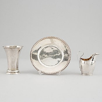 Beaker, silver 1835, cream-jug, silver 1826 and bread-plate, silver 1952.