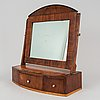 A swedish empire mirror with drawer, first half of the 19th century.