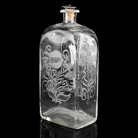 A glass bottle and three vodka glasses, 19th century.
