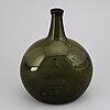 A green glass bottle, 19th century.