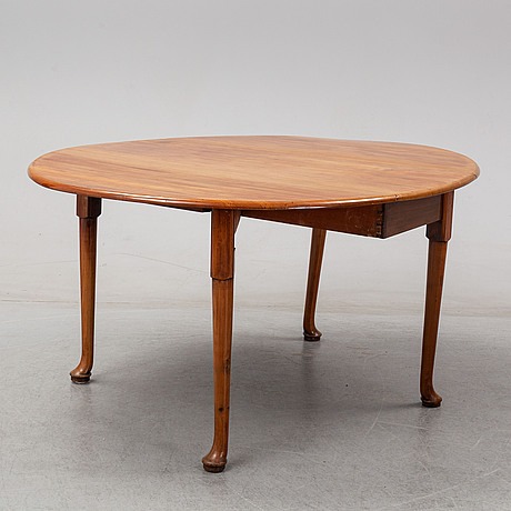 An end of the 19th century mahogany drop leaf table.