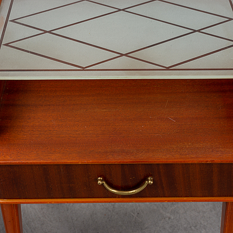A pair of 1950s bedside tables.