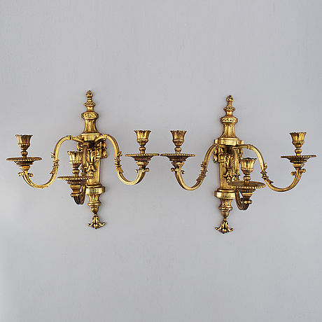 A pair of gilt bronze louis xvi style wall lights. late 19th century. 80.