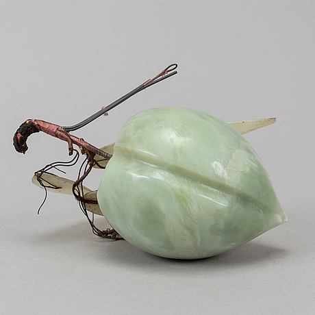 A nephrite carving of a peach, china, mid 20th century.