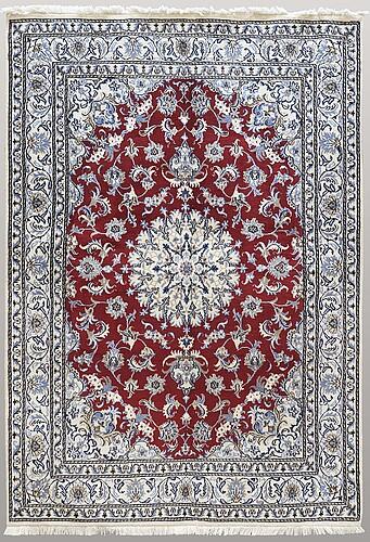 A carpet, nain, part silk, 241 x 165 cm.