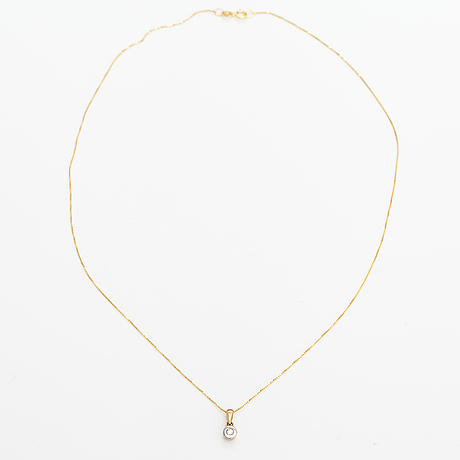 A 14k gold necklace with a ca. 0.10 ct diamond.