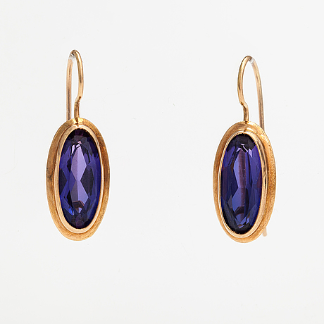 A pair of 14k gold earrings with synthetic sapphires. finland.