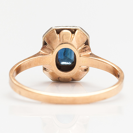 A 14k gold ring with a sapphire and dimaonds ca. 0.10 ct in total. matti valkila, helsinki 1990.