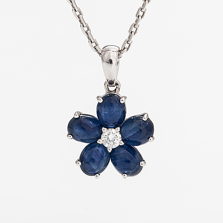 An 18k white gold necklace with sapphires and a diamond ca. 0.06 ct.