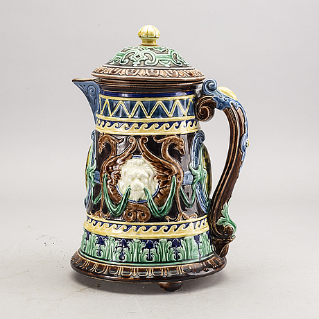 A swedish rörstrand majolica jug dated 1878.