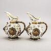 A pair of rörstrand majolica jugs around 1900.