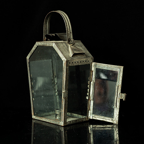An 18th century tinplate lantern.