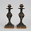 A pair of painted tinplate candlesticks, mid 19th century.
