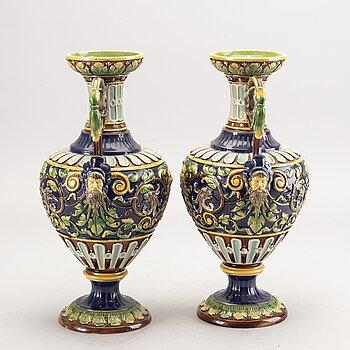 A pair of majolica urns around 1900.