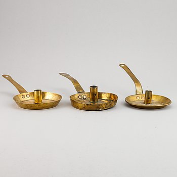 Three 18th century brass night light holders.