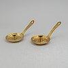 A pair of 19th century brass night light holders.