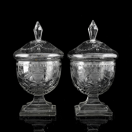 A pair of cut glass jars with covers, late 19th century.
