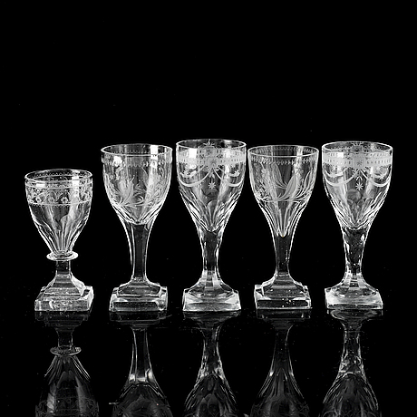 A matched set of 21 wine glasses, 19th/20th century.