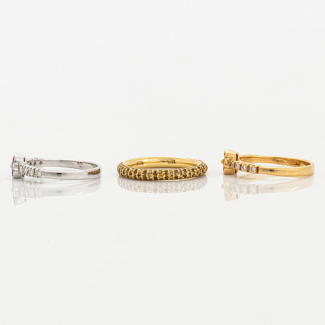 Yellow and pink sapphire and brilliant-cut diamond three rings.