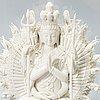 An oriental buddha statue in porcelain.