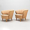 A pair of 1940s armchairs.