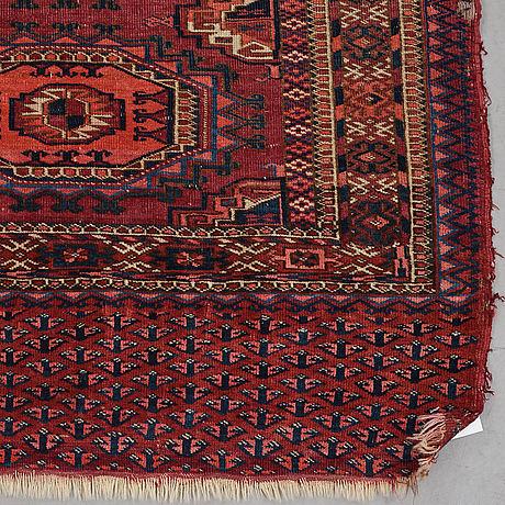 A rug, semi-antique tekke chuval, ca 142 x 72 cm.