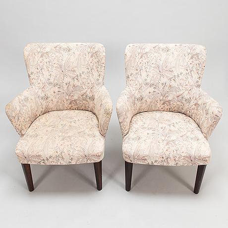 Carl-johan boman, a pair of armchairs by boman oy.