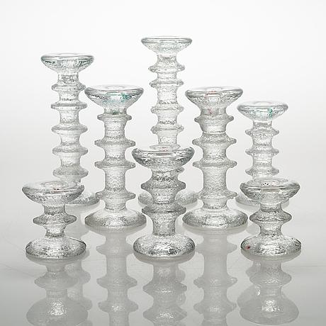 Timo sarpaneva, an 8-piece set of 'festivo' glass candlesticks for iittala.