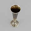 A russian silver gilt and niello champagne flute, unidentified makers mark, moscow 1843.