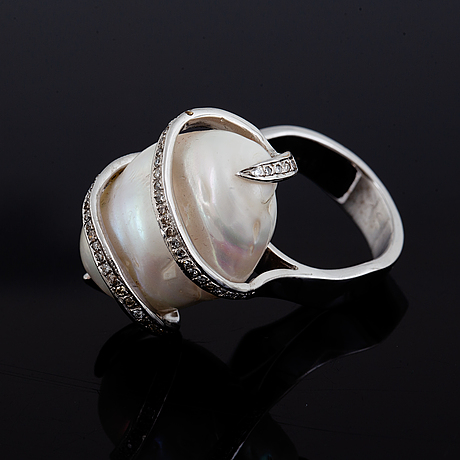 18k white gold large cultured baroque pearl and diamond ring.