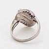 18k white gold and diamond ring.