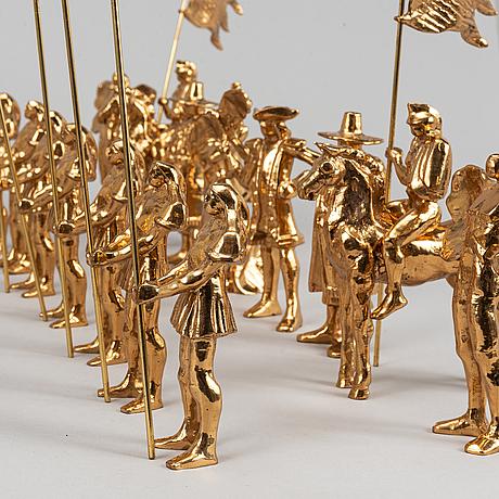 A set of 32 brass chessmen by bo åke adamsson for skultuna bruk.