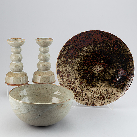 Gustav kraitz, a set of bowl, platter, and a pair of candle sticks, stoneware, signed.