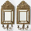 An early 20th century pair of baroque style mirror sconses.