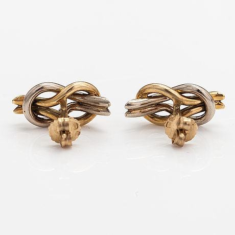 A pair of 14k white and yellow gold.
