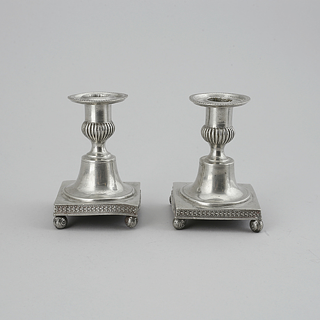 Five 19th century pewter candlesticks.