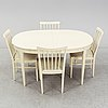 A dining table with six chairs by carl malmsten. second half of the 20th century.