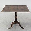 A tilt top table, 19th century.